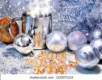 Christmas decoration with balls, tree and a cup of hot coffee