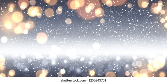Christmas decoration banner - snowy blue background with blurry light bokeh