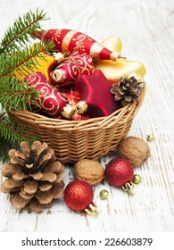 Christmas Decoration in basket on a wooden background