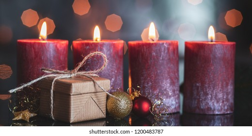 christmas decoration with christmas bauble and candle for advent season four candles burning