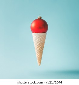 Christmas decoration bauble in ice cream cone. New Year minimal concept.