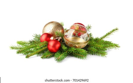 Photo of Christmas decoration baubles with branches of fir tree on white background