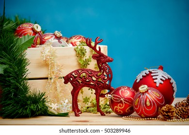 Christmas decoration with baubles christmas ornaments on wooden table over blue grunge background