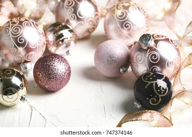Christmas decoration. Christmas baubles in pink color on white background