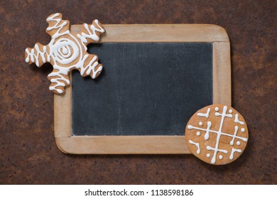 Christmas decoration. Blackboard and gingerbread cookie. Empty space for text.