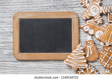 Christmas decoration. Blackboard with gingerbread cookies. Empty space for text.