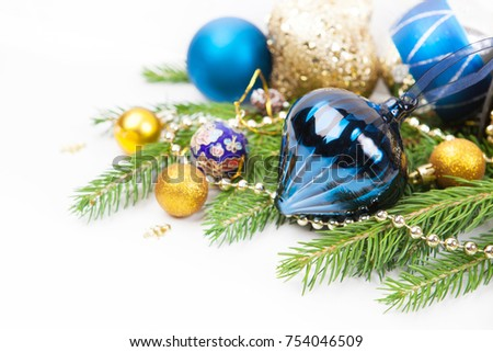 christmas decoration with blue and gold baubles in sequins ornament and silver lines fir