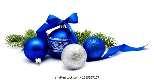 Christmas decoration blue and silver balls with ribbon and fir tree branches isolated on a white background