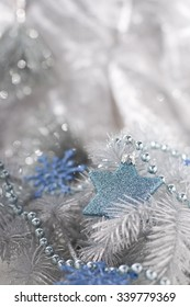 Christmas decoration with blue star bauble, blue snowflakes and chain.