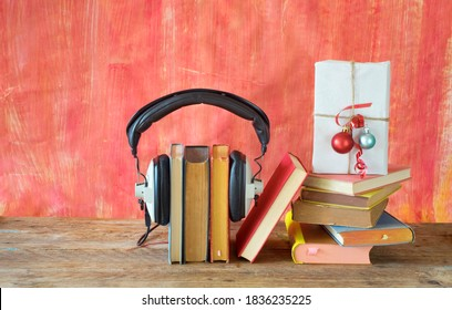 christmas decoration with books and vintage headphone, audio book gift concept