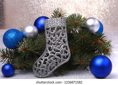 Christmas decoration. The boots of Santa Claus and Christmas tree branches on wooden background