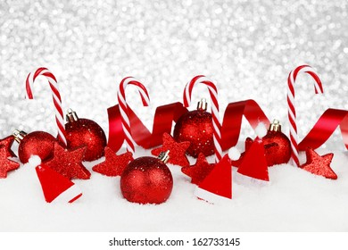 Christmas decoration and candies on snow