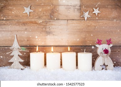 christmas decoration with candles for advent season three candle burning