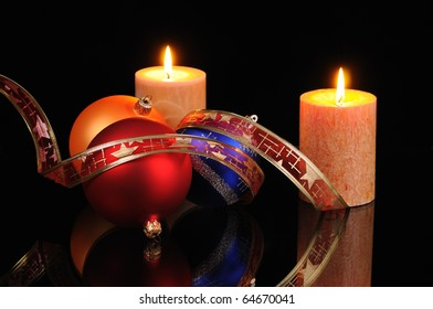 Christmas decoration with candles on a black background