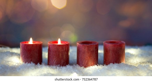 christmas decoration  candles in snow for advent season two candles burning