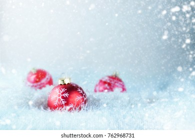 Christmas decoration. Christmas Card - Baubles With Bow On Snow