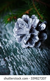 Christmas decoration card with evergreen fir tree, cones, Selective focus, shallow dof