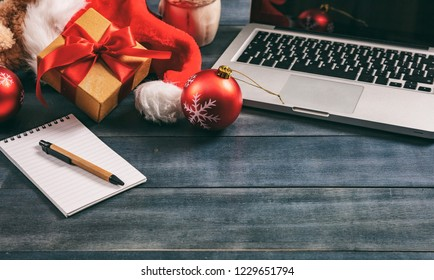 Christmas decoration and a computer laptop on an office desk, copy space