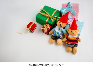 Christmas decoration with a couple Lovely bear, a gift,  christmas tree, and ribbon