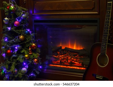 Christmas decoration in cozy house loft, fireplace Christmas tree and guitar