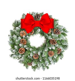 Christmas decoration evergreen wreath with cones and red ribbon bow isolated on white background