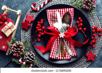 Christmas decoration. Festive plate and cutlery with Christmas decoration. Christmas background