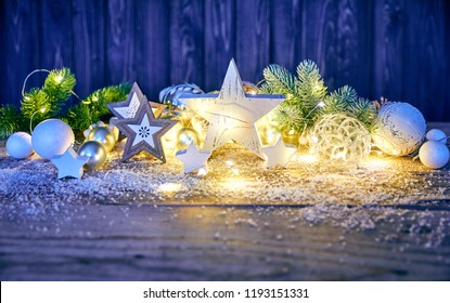 Christmas decoration for firtree glass balls garland and star on old wooden board in rustic style. Greeting card with copyspace top view.
