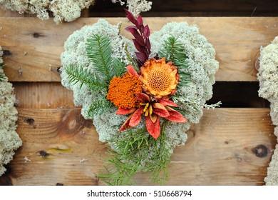 Christmas decoration with flower and plants on wooden wall