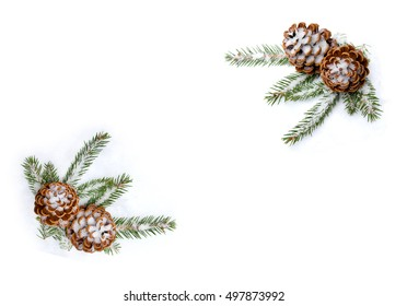 Christmas decoration. Frame of cones pine and branch christmas tree on snow on white background with space for text. Flat lay