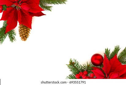 Christmas decoration. Frame of flower of red poinsettia, branch christmas tree, christmas ball, red berry and cone spruce on a white background with space for text. Top view, flat lay