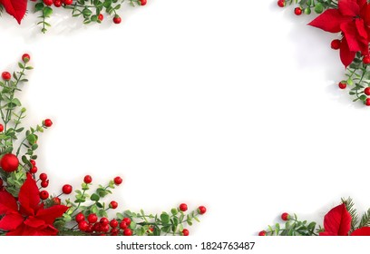 Christmas decoration. Frame of flowers of red poinsettia, branch christmas tree, red berries on white background with space for text. Top view, flat lay
