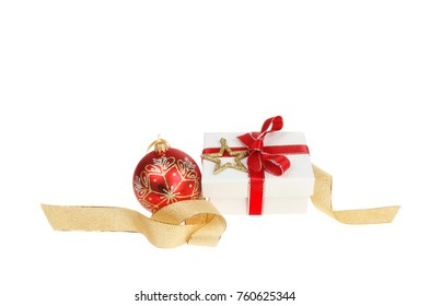 Christmas decoration, gift box with red bauble, ribbon and a gold glitter star isolated against white