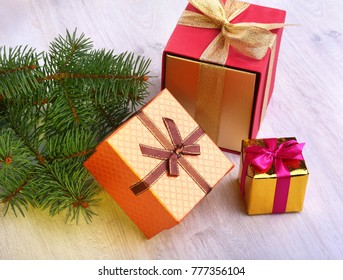 Christmas decoration with gift boxes and christmas tree on a blurry, sparkling and fabulous background.