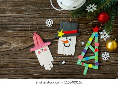 Christmas decoration or Christmas gift wooden sticks - Snowman, fir-tree and Santa. Handmade. Project of children's creativity, handicrafts, crafts for kids.