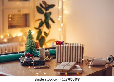 Christmas decoration at gift wrapping table
