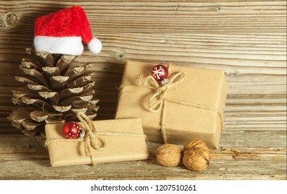 Christmas decoration with gifts against wooden background