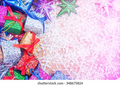 Christmas decoration with gifts and star on wooden background