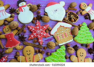 Christmas decoration and gingerbread cookies on wooden background
