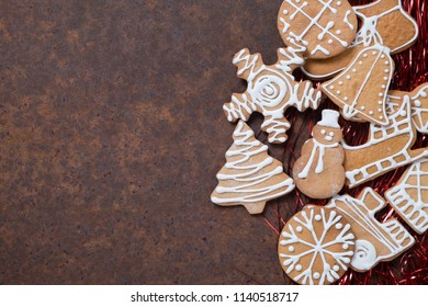 Christmas decoration. Gingerbread on a brown old rusty metal table. Empty space for text.