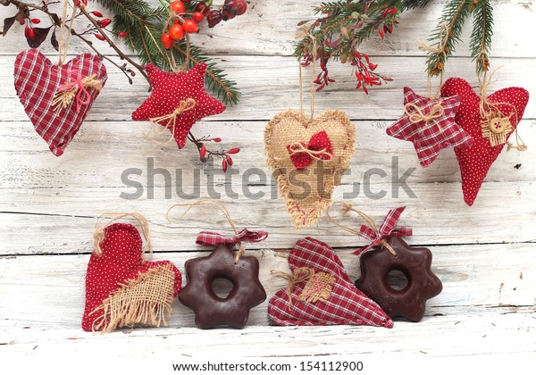 Christmas decoration and gingerbread over wooden background