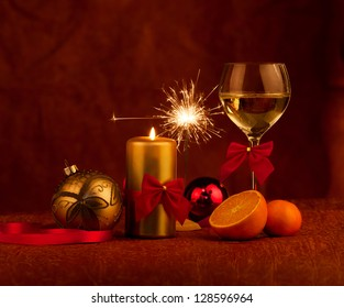 Christmas decoration glass with champagne and burning candles sparkler