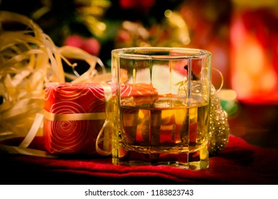 Christmas decoration and glass of whiskey