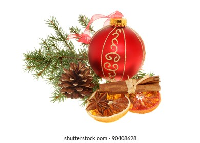 Christmas decoration, gold and red bauble, dried orange cinnamon, pinecone and foliage