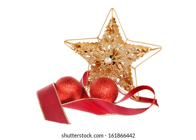 Christmas decoration of a gold star with a red ribbon and red baubles isolated against white