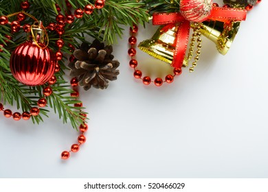 Christmas decoration with golden bell, pine cones and branch