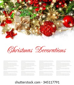 Christmas decoration golden ornaments and lights. Festive still life wit sample text.