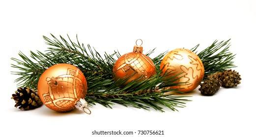 Christmas decoration golden yellow balls with fir cones and fir tree branches isolated on a white background
