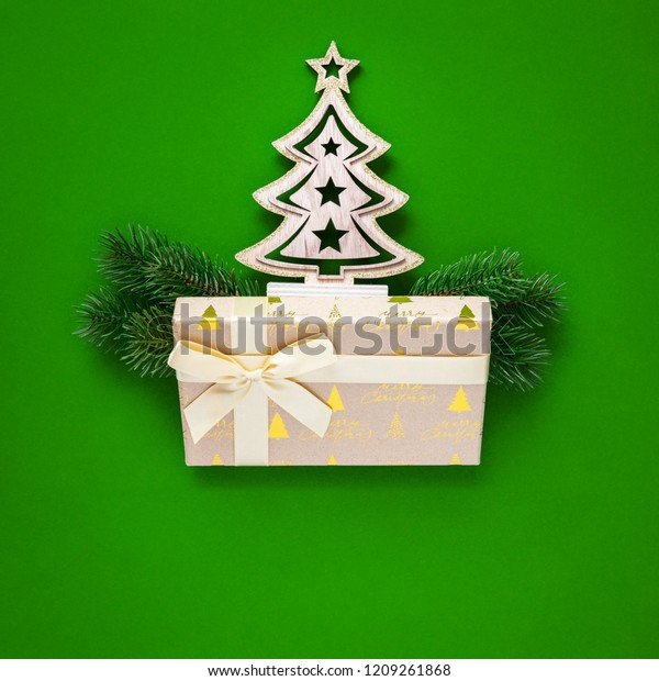 A Christmas decoration green background with fir tree and gift box