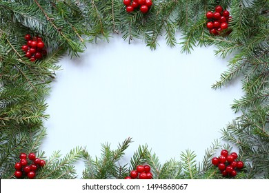Christmas decoration of green fir branches and red berries