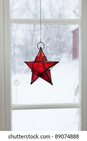 christmas decoration hanging in the window